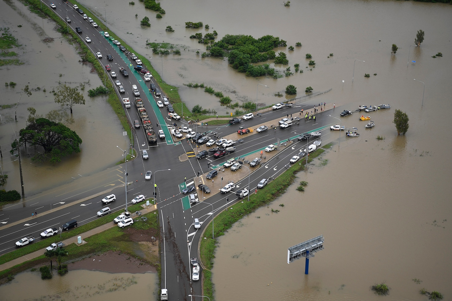 A major intersection is blocked by floodwaters in the Townsville suburb of Idalia, Australia, on Feb. 4. Record rainfall forced authorities to open the floodgates on the swollen Ross River dam. (Ian Hitchcock/Getty Images)