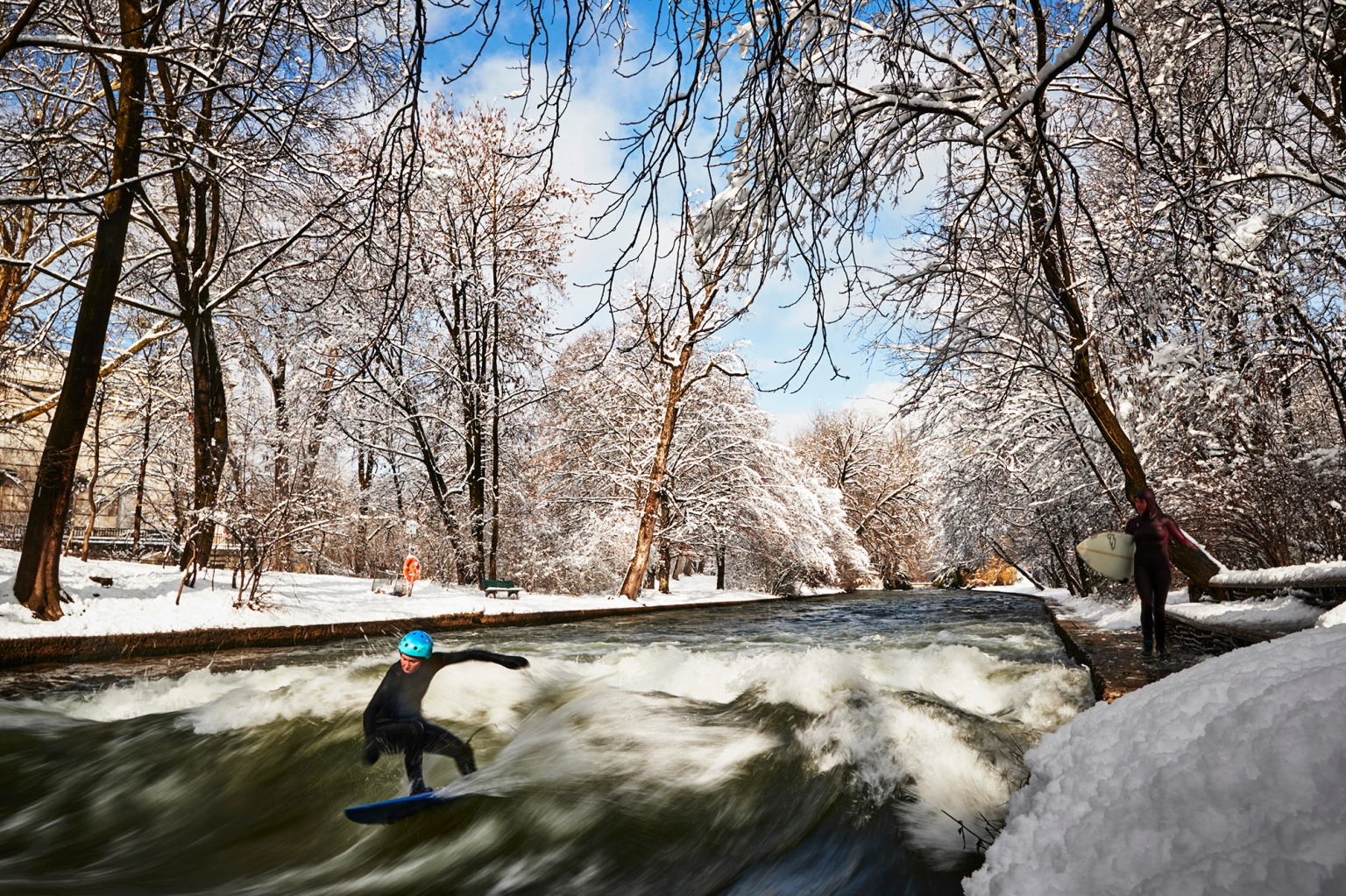 A surfer rides the Eisbach wave in the English Garden in Munich, Germany, on Feb. 4. The manmade wave wave became legal to ride in 2010 and is recommended for only experienced surfers due to its forceful currents and the concealed concrete riverbed. (Adam Pretty/Getty Images)