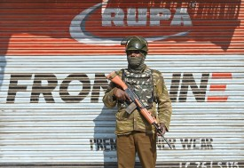 An Indian paramilitary trooper stands guard during the second day of strikes called by separatists against the National Investigation Agency raids at residences in Srinagar on Feb. 28. (Tauseef Musafa/AFP/Getty Images)
