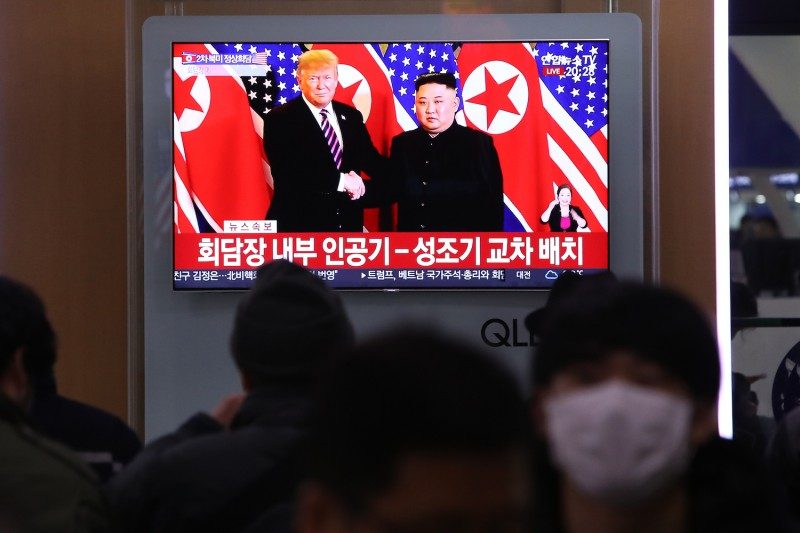 South Koreans watch U.S. President Donald Trump meet with North Korean leader Kim Jong Un on a television screen at a railway station in Seoul on Feb. 27. (Chung Sung-Jun/Getty Images)