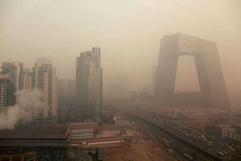 Heavy pollution surrounds the China Central Television (CCTV) headquarters building in Beijing on Jan. 18, 2012. (Ed Jones/AFP/Getty Images)