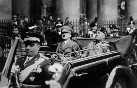 Adolf Hitler riding in a car with Italian dictator Benito Mussolini in Munich in Sept. 1937. (AFP/Getty Images)