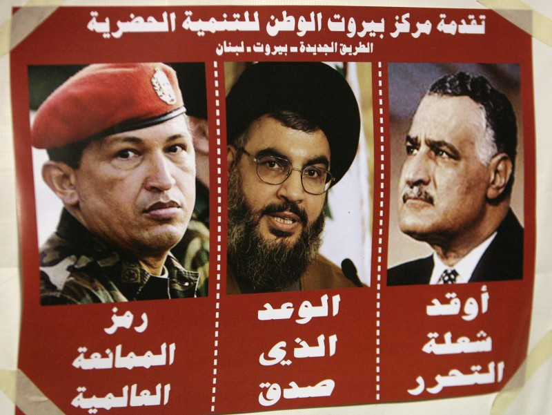 A poster shows Hezbollah secretary general Hassan Nasrallah, Venezuelan President Hugo Chavez, and Arab leader Jamal Abdel Nasser on Dec. 7, 2006 in Beirut. (Ramzi Haidar/AFP/Getty Images)