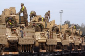 Members of the U.S. Army 1st Brigade, 1st Cavalry Division, transport heavy combat equipment including Bradley Fighting Vehicles at the railway station near the Rukla military base in Lithuania on Oct. 4, 2014. (Petras Malukas/AFP/Getty Images)