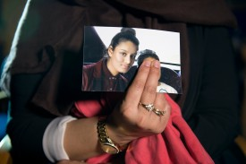Renu Begum, the eldest sister of Shamima Begum, holds a photo of her teen sister, who fled to Syria to join the Islamic State, as she is interviewed by the media at New Scotland Yard in London on Feb. 22, 2015. (Laura Lean/Getty Images)