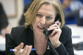 Former Israeli Foreign Minister Tzipi Livni speaks on the phone to constituents in Tel Aviv on March 15, 2015. (Jack Guez/AFP/Getty Images)