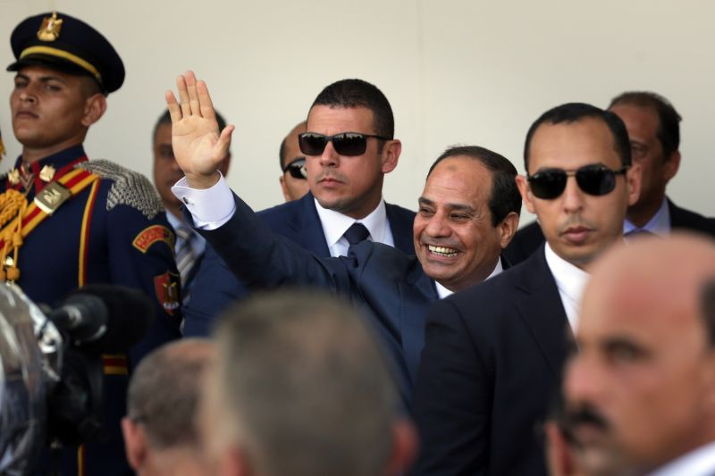 Egyptian President Abdel Fattah al-Sisi waves during the opening ceremony of the new Suez Canal expansion in Suez on Aug. 6, 2015. (David Degner/Getty Images)