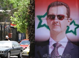 An election campaign poster bearing a portrait of President Bashar al-Assad in Damascus on May 18, 2014. (Louai Bashara/AFP/Getty Images)