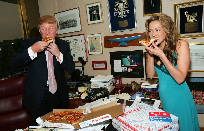 Donald Trump eats pizza at his office in Trump Tower on April 1, 2005 in New York City. (Evan Agostini/Getty Images)