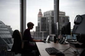 A member of staff poses for a photograph at a workspace in the National Cyber Security Centre on Feb. 14, 2017 in London, England. (Carl Court/Getty Images)