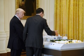AT&T executive Randall Stephenson, right, explains  5G cellular network deployment to U.S. President Donald Trump on June 22, 2017. (Olivier Douliery/Pool/Getty Images)