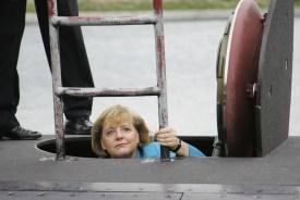 German Chancellor Angela Merkel tours the German submarine, U33, on Aug. 31, 2006 in Warnemuende, Germany. (Andreas Rentz/Getty Images)