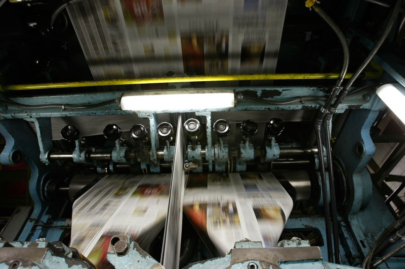 Freshly printed copies of the San Francisco Chronicle run through the printing press at one of the Chronicle's printing facilities in San Francisco on Sept. 20, 2007. (Justin Sullivan/Getty Images)