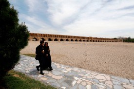 "Iranians walk near the ""Si-o-Se Pol"" bridge (33 Arches bridge) over the Zayandeh Rud river in Isfahan on April 11, 2018.  (Atta Kenare/AFP/Getty Images)"