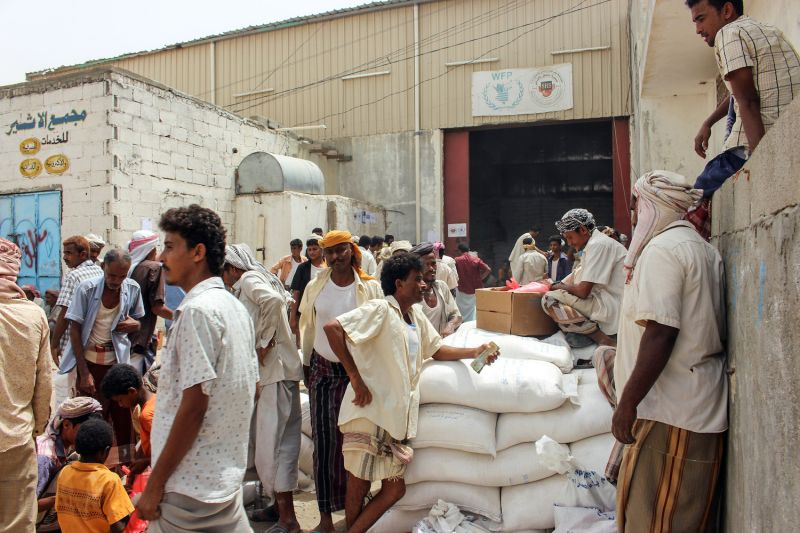 Yemeni civilians receive food aid in the northern district of Abs, under the control of Iran-backed Houthi rebels, on June 24, 2018. (Essa Ahmed/AFP/Getty Images)