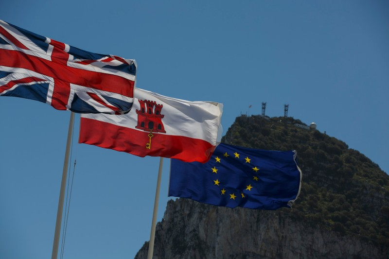 The flags of the United Kingdom, Gibraltar, and the European Union are flown with the Rock of Gibraltar in the background at the Spain-Gibraltar border on April 4, 2017. (Pablo Blazquez Dominguez/Getty Images)