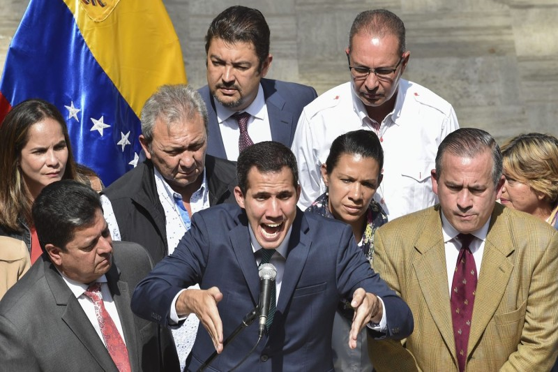Venezuela's opposition leader and self-proclaimed acting president Juan Guaidó speaks to the press at the Federal Legislative Palace, in Caracas, on February 4, 2019.