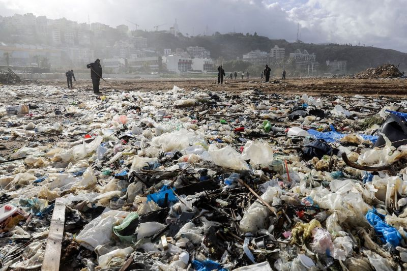 Workers clean the beach of the coastal town of Zouk Mosbeh, north of Beirut, on Jan. 23, 2018, as garbage washed ashore after stormy weather. (Joseph Eid/AFP/Getty Images)