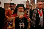 Jerusalem's Greek Orthodox patriarch, Theophilos III (center), arrives at the Church of the Nativity in the occupied West Bank town of Bethlehem on Jan. 6. (Musa al-Shaer/AFP/Getty Images)