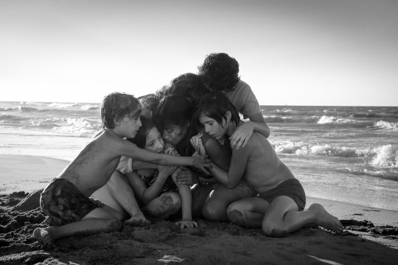 "From left to right: Marco Graf as Pepe, Daniela Demesa as Sofi, Yalitza Aparicio as Cleo, Marina De Tavira as Sofía, Diego Cortina Autrey as Toño, and Carlos Peralta Jacobson as Paco in ""Roma,"" written and directed by Alfonso Cuarón. (Carlos Somonte via Netflix)"