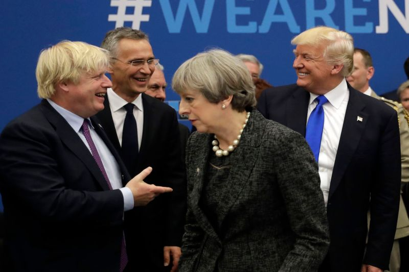 Then-British Foreign Secretary Boris Johnson, NATO Secretary General Jens Stoltenberg, Britain's Prime Minister Theresa May, and U.S. President Donald Trump arrive for a working dinner meeting at the NATO summit in Brussels, on May 25, 2017.