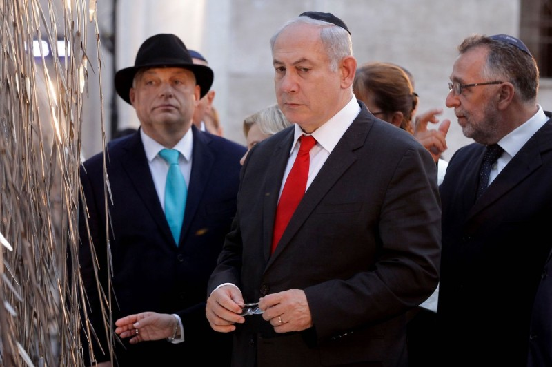 Israeli Prime Minister Benjamin Netanyahu (center) and Hungarian Prime Minister Viktor Orban  (left) in the Raoul Wallenberg memorial garden of Budapest synagogue in Budapest on July 19, 2017. (Peter Kohalmi/AFP/Getty Images)