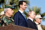 Russian President Vladimir Putin, Syrian President Bashar al-Assad, Russian Defense Minister Sergei Shoigu (R), and Syrian Armed Forces' chief of staff Ali Abdullah Ayyoub (L) inspecting a military parade in the northwestern Syrian province of Latakia.