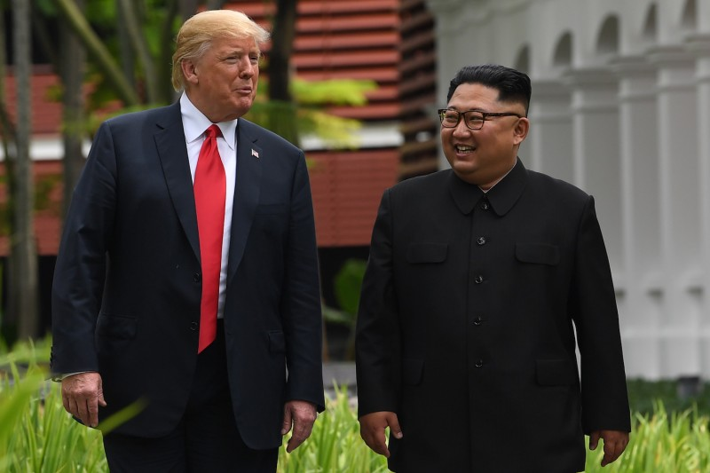 North Korean leader Kim Jong Un walks with U.S. President Donald Trump during a break in their historic summit in Singapore on June 12, 2018. (Saul Loeb/AFP/Getty Images)