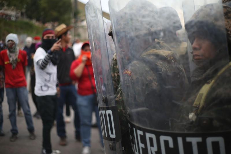 Soldiers monitor a protest in Tegucigalpa, Honduras, on Dec. 15, 2017. (Delmer Membreno/Picture-Alliance/DPA/AP)