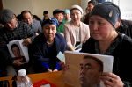 Gulnur Kosgeulet shows a photo of her husband, Ekpor Sorsenbek, whom she believes is in a re-education camp in Xinjiang, in Almaty, Kazakhstan, on Jan. 21. (Reid Standish for Foreign Policy)