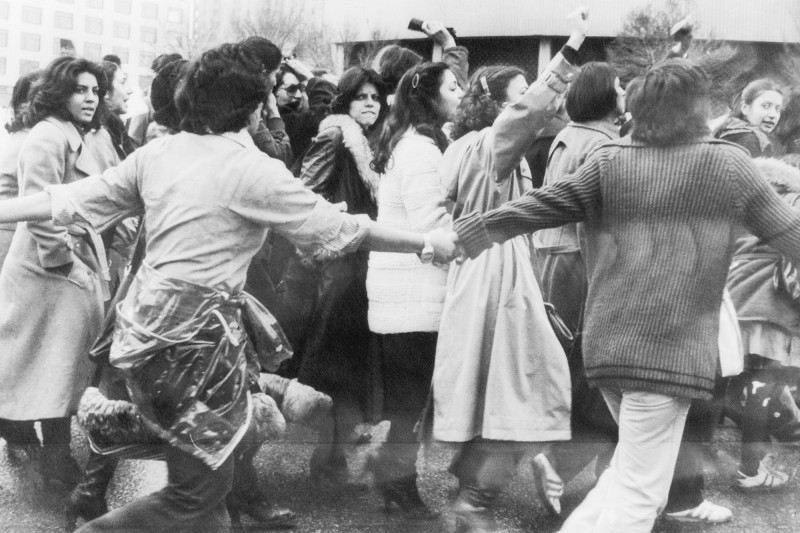Protesters against the veil, protected by young men, march in central Tehran during demonstrations for women's rights on March 10, 1979. (Bettmann Archives/Getty Images)