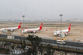 Three Boeing 737 Max 8 planes from Shanghai Airlines parked at Shanghai Hongqiao International Airport on March 11, 2019.