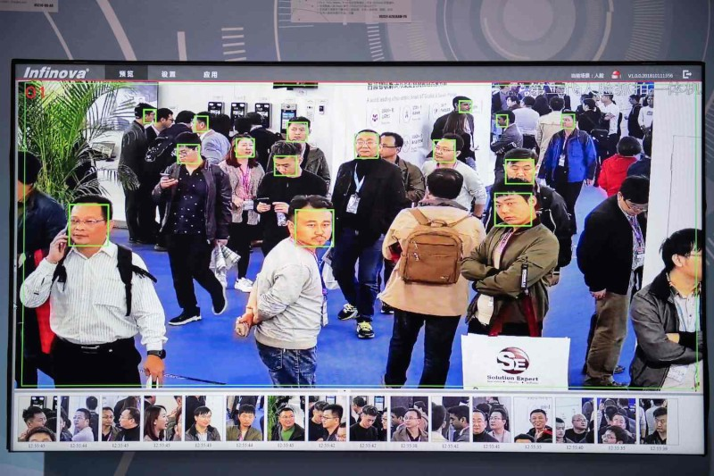 A screen shows visitors being filmed by AI security cameras with facial recognition technology at the 14th China International Exhibition on Public Safety and Security at the China International Exhibition Center in Beijing on Oct. 24, 2018.