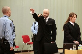 Norwegian mass murder Anders Behring Breivik makes a Nazi salute before his appeal hearing at a court at the Telemark prison in Skien, Norway, on Jan. 10, 2017.