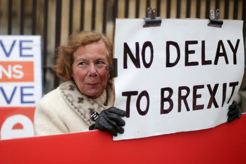 A pro-Brexit activist holds a placard outside the Houses of Parliament in central London on March 20.