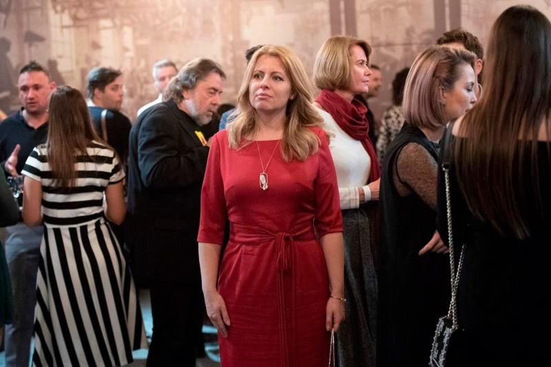 Presidential candidate Zuzana Caputova (C) waits for the first exit polls at her election headquarters during the first round of the presidential elections in Bratislava, Slovakia, on March 16, 2019.