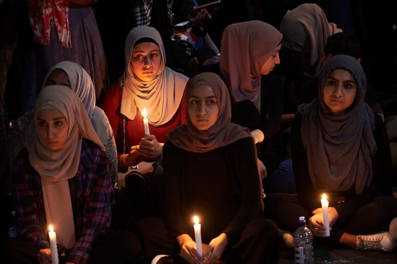 Mourners gather outside the State Library of Victoria in Melbourne, Australia after a 28-year-old Australian-born man, Brenton Tarrant, appeared in Christchurch District Court on Saturday charged with murder for killing 49 people at mosques in Christchurch, New Zealand. The attack is the worst mass shooting in New Zealand's history.