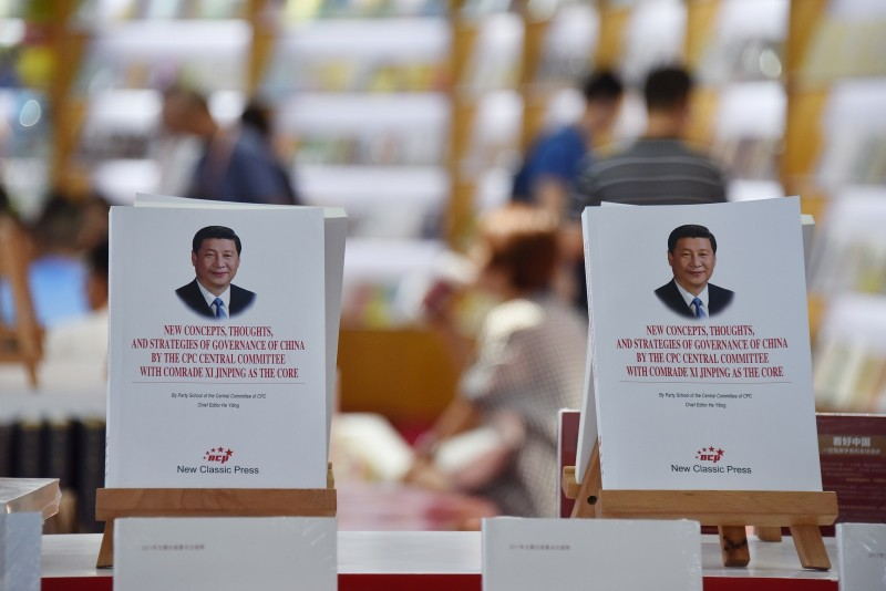 Books about Chinese President Xi Jinping are displayed at the Beijing International Book Fair in Beijing on Aug. 23, 2018. (Greg Baker/AFP/Getty Images)