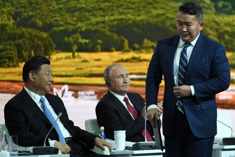 China's President Xi Jinping (L), Mongolia's President Khaltmaagiin Battulga (R) and Russian President Vladimir Putin (C) attend the plenary session of the Eastern Economic Forum in Vladivostok on September 12, 2018. (Kirill Kudryavtsev/AFP/Getty Images)