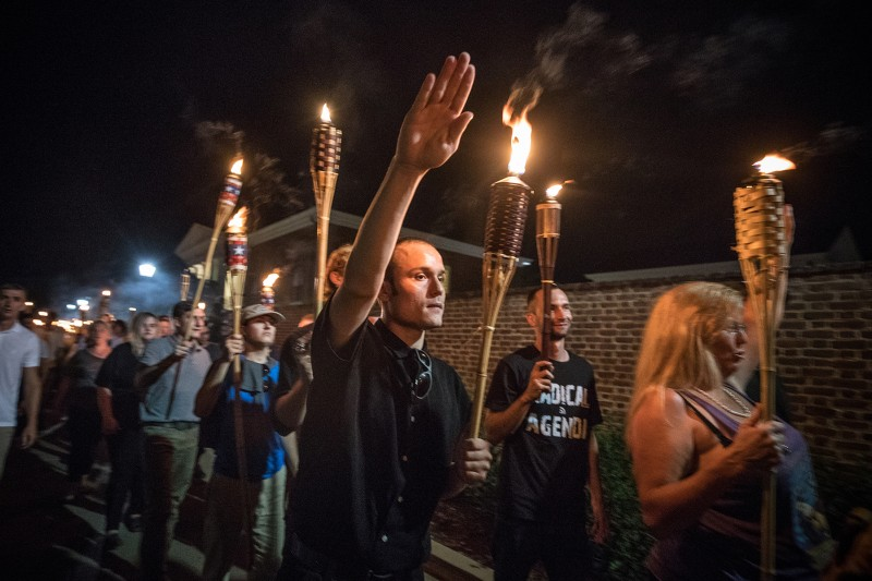 Several hundred white supremacists carrying tiki torches march through the University of Virginia campus in Charlottesville on Aug. 11, 2017. (Evelyn Hockstein/For The Washington Post via Getty Images)
