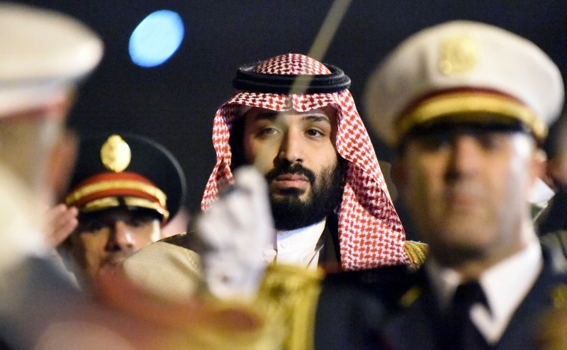 Saudi crown prince Mohammed bin Salman is seen behind a military band upon his arrival in Algiers, Algeria on Dec. 2, 2018. (Ryad Kramdi/AFP/Getty Images)