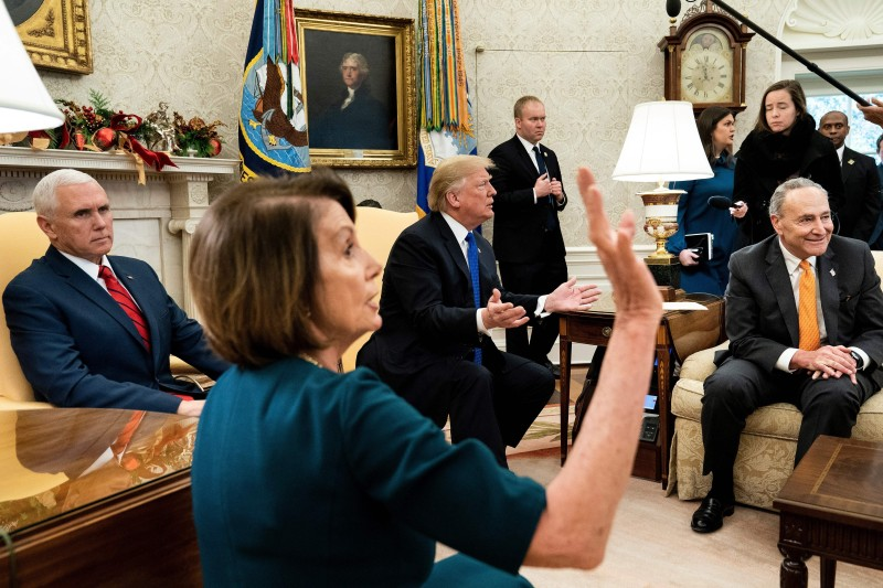 Vice President Mike Pence listens while Speaker Nancy Pelosi and Senate Minority Leader Charles E. Schumer argue with President Donald Trump at the White House on Dec. 11, 2018 in Washington. (Brendan Smalowski/AFP/Getty Images)
