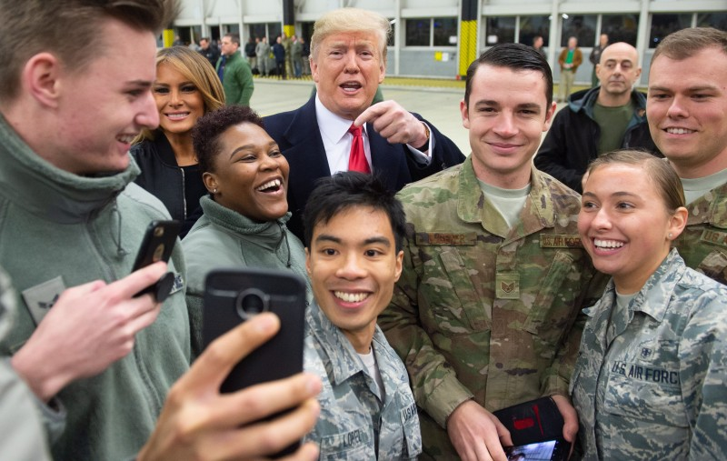 President Donald Trump and First Lady Melania Trump greet members of the U.S. military during a stop at Ramstein Air Base in Germany, on Dec. 27, 2018. (Saul Loeb/AFP/Getty Images)