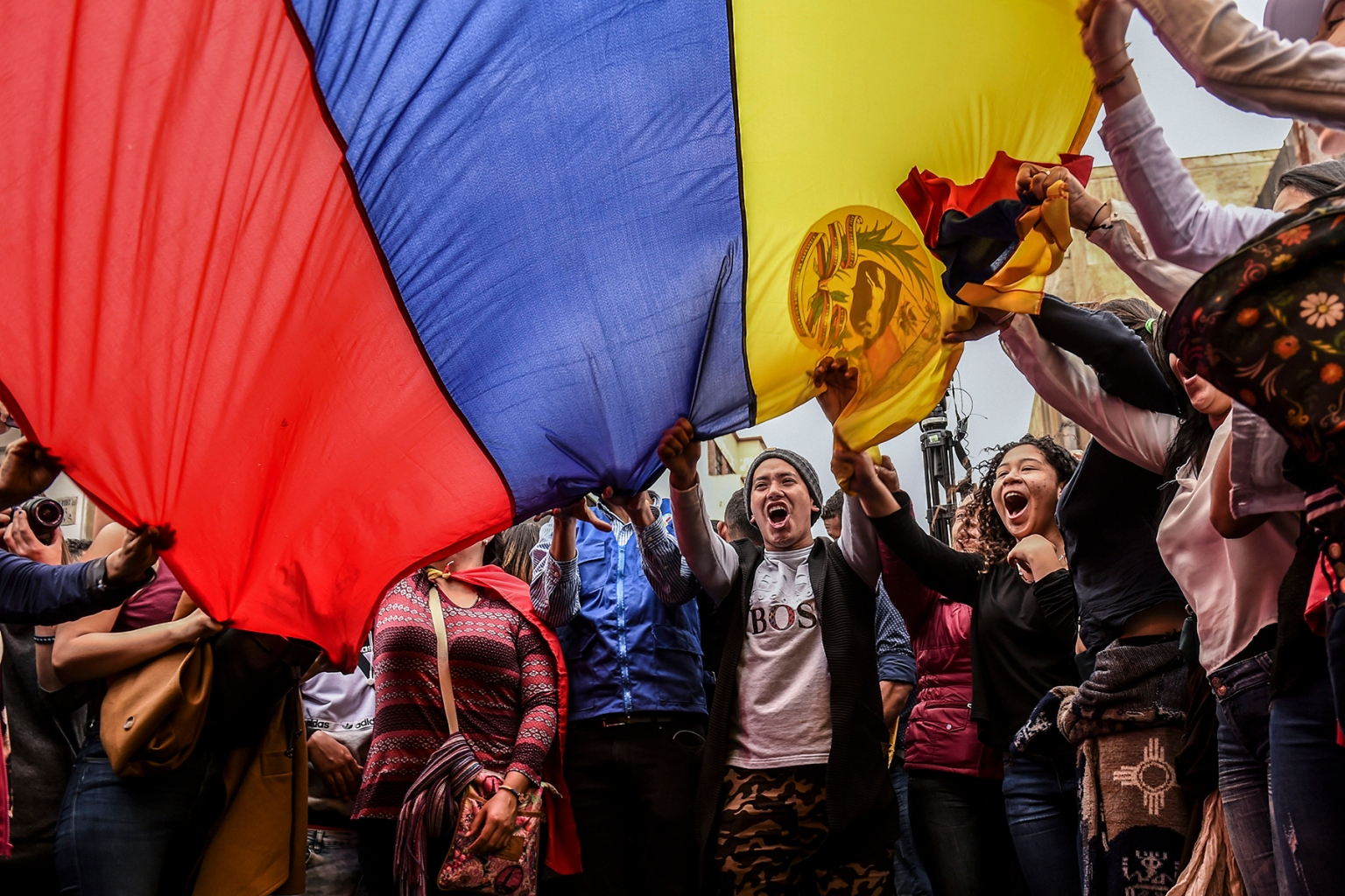 Supporters of Venezuelan opposition leader and self-declared acting president Juan Guaidó shout slogans during a demonstration outside Colombia's Foreign Ministry in Bogota, where Guaidó met with members of a multinational support group to tackle next steps in the country's crisis on Feb. 25. JOAQUIN SARMIENTO/AFP/Getty Images