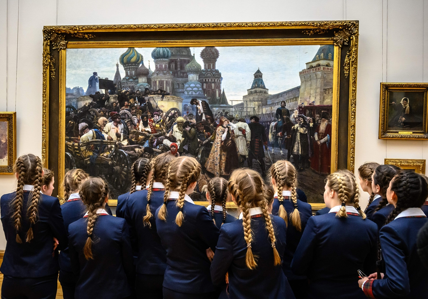 "Schoolgirls look at ""The Morning of the Streltsy Execution"" by Russian painter Vasily Surikov at The State Tretyakov Gallery in Moscow on Feb. 26. MLADEN ANTONOV/AFP/Getty Images"