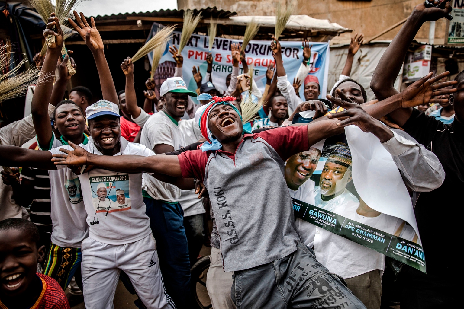 "People celebrate take to Kano's streets to celebrate the re-election of Muhammadu Buhari as Nigerian president after a delayed poll that angered voters on Feb. 27. The opposition immediately vowed to challenge the ""sham"" result in court. LUIS TATO/AFP/Getty Images"