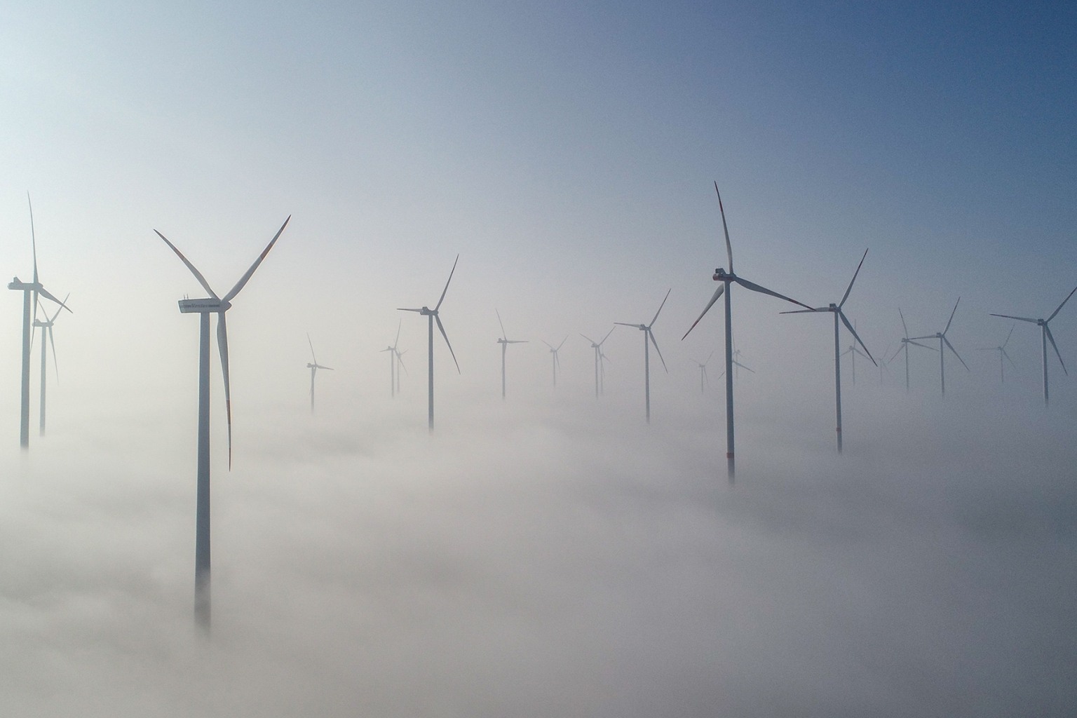 Wind turbines poke above the morning fog at a wind farm in Jacobsdorf, Germany, on Feb. 27. PATRICK PLEUL/AFP/Getty Images