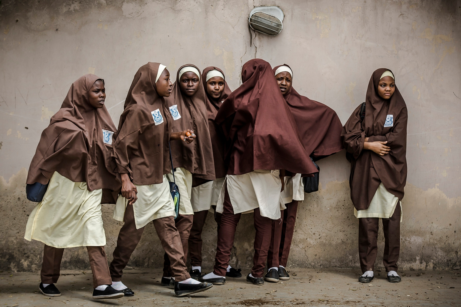 A group of girls leave their school during a rally by All Progressives Congress party supporters celebrating the re-election of the incumbent president and the leader of party in Kano, Nigeria, on Feb. 27. (Luis Tato/AFP/Getty Images)