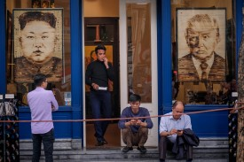 Art depicting North Korean leader Kim Jong Un and U.S. President Donald Trump is on display at local stores during their summit in Hanoi on Feb. 28. (Linh Pham/Getty Images)