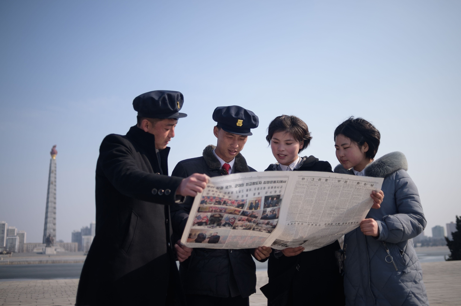 North Korean students read the Rodong Sinmun newspaper coverage of Kim Jong Un's visit to  Vietnam for a summit in Hanoi with U.S. President Donald Trump on Kim Il Sung square in Pyongyang on Feb. 28. KIM WON JIN/AFP/Getty Images
